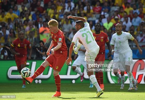 Belgium's midfielder Kevin De Bruyne and Algeria's forward Riyad Mahrez vie for the ball during a Group H football match between Belgium and Algeria...