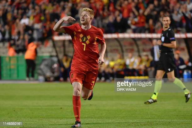 Belgium's midfielder Kevin De Bruyne celebrates after scoring a goal during the UEFA Euro 2020 qualification football match between Belgium and...