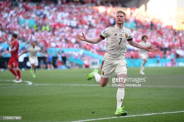 Belgium's midfielder Kevin De Bruyne celebrates after scoring the team's second goal during the UEFA EURO 2020 Group B football match between Denmark...