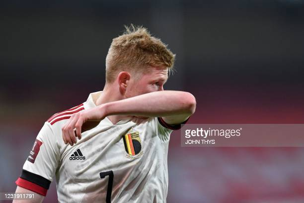 Belgium's midfielder Kevin De Bruyne gestures during the FIFA World Cup Qatar 2022 qualification football match between Belgium and Wales at the Den...
