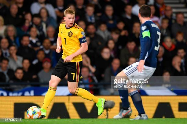 Belgium's midfielder Kevin De Bruyne is pressured by Scotland's defender Andrew Robertson during the Euro 2020 football qualification match between...