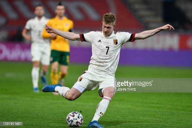 Belgium's midfielder Kevin De Bruyne kicks the ball during the FIFA World Cup Qatar 2022 qualification football match between Belgium and Wales at...