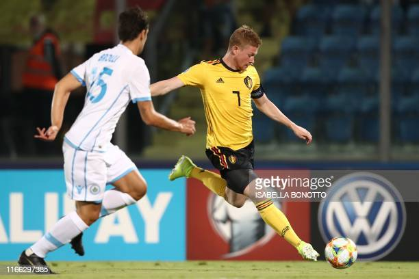 Belgium's midfielder Kevin De Bruyne outruns San Marino's defender Cristian Brolli during the Euro 2020 qualifier football match San Marino vs...