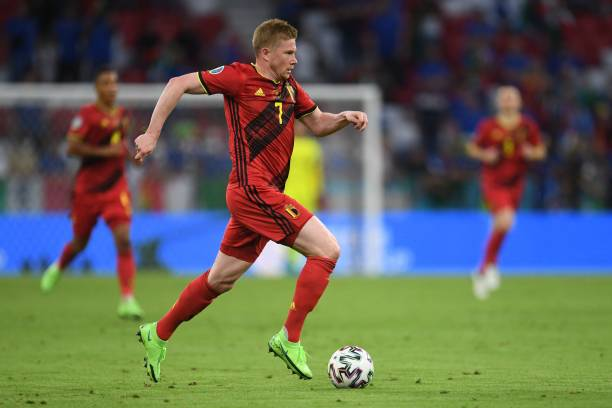 Belgium's midfielder Kevin De Bruyne runs with the ball during the UEFA EURO 2020 quarter-final football match between Belgium and Italy at the...