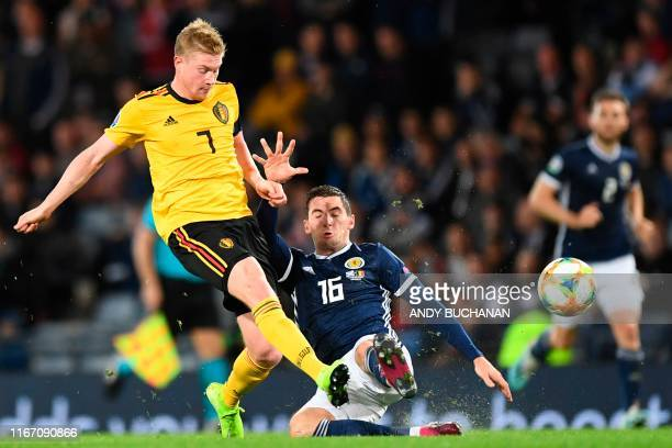 Belgium's midfielder Kevin De Bruyne shoots as Scotland's midfielder Kenny McLean tries to block during the Euro 2020 football qualification match...