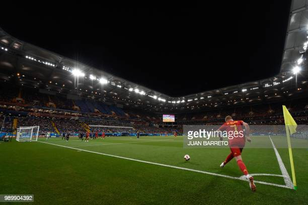Belgium's midfielder Kevin De Bruyne takes a corner during the Russia 2018 World Cup round of 16 football match between Belgium and Japan at the...