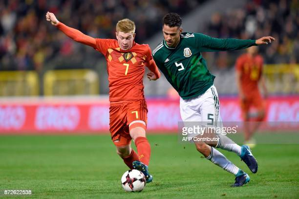 Belgium's midfielder Kevin Debruyne vies with Mexico's defender Diego Reyes during the international friendly football match between Belgium and...