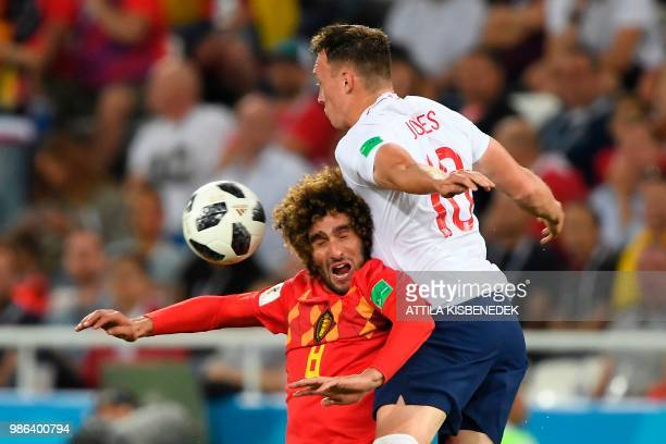 TOPSHOT Belgium's midfielder Marouane Fellaini and England's defender Phil Jones vie for the ball during the Russia 2018 World Cup Group G football...