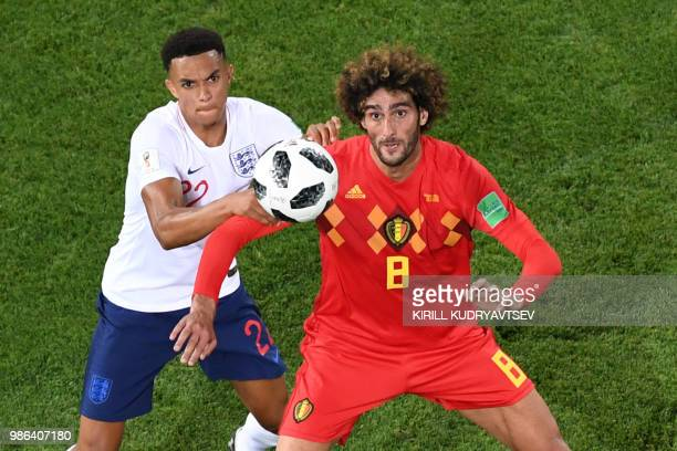 TOPSHOT Belgium's midfielder Marouane Fellaini and England's defender Trent AlexanderArnold during the Russia 2018 World Cup Group G football match...