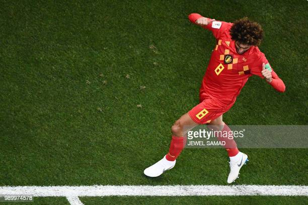TOPSHOT Belgium's midfielder Marouane Fellaini celebrates after scoring his team's second goal during the Russia 2018 World Cup round of 16 football...