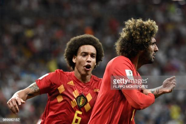 TOPSHOT Belgium's midfielder Marouane Fellaini celebrates with Belgium's midfielder Axel Witsel after scoring the equaliser during the Russia 2018...