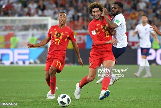 Belgium's midfielder Marouane Fellaini clashes with England's defender Danny Rose beside Belgium's midfielder Youri Tielemans during the Russia 2018...