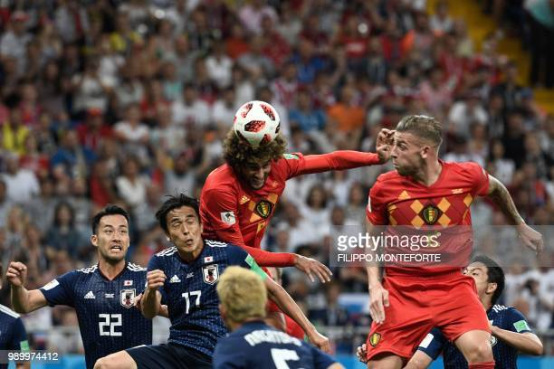 Belgium's midfielder Marouane Fellaini heads to score the equaliser during the Russia 2018 World Cup round of 16 football match between Belgium and...