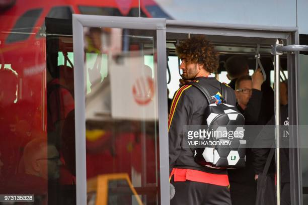 Belgium's midfielder Marouane Fellaini is seen in a bus upon the team's arrival at Moscow's Sheremetyevo airport on June 13 ahead of the Russia 2018...