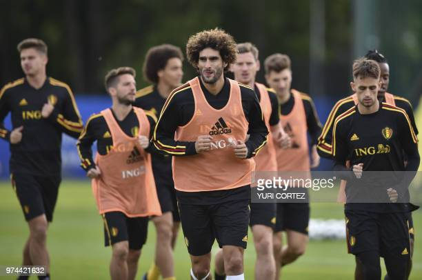 Belgium's midfielder Marouane Fellaini warms up as he take part in a training session at the Dedovsk stadium in Moscow on June 14 2018 during the...