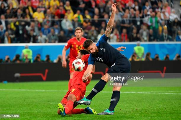 TOPSHOT Belgium's midfielder Moussa Dembele and France's forward Olivier Giroud vie for the ball during the Russia 2018 World Cup semifinal football...