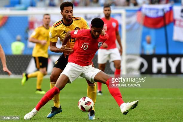 Belgium's midfielder Moussa Dembele vies with England's forward Marcus Rashford during their Russia 2018 World Cup playoff for third place football...