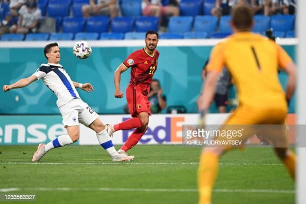 Belgium's midfielder Nacer Chadli crosses the ball as he is marked by Finland's defender Jukka Raitala during the UEFA EURO 2020 Group B football...