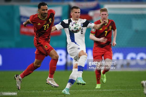 Belgium's midfielder Nacer Chadli vies for the ball with Finland's midfielder Robin Lod during the UEFA EURO 2020 Group B football match between...
