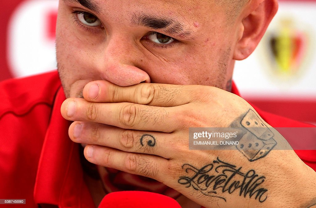 Belgium's midfielder Radja Nainggolan attends a press conference after a training session at Le Haillan, on June 8, 2016, two days prior to the beginning of the Euro 2016 football tournament. / AFP / EMMANUEL