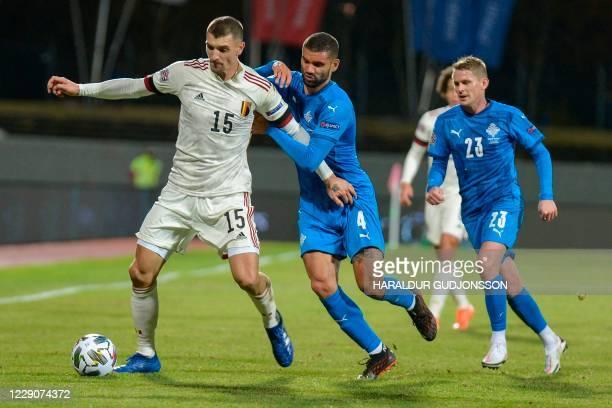 Belgium's midfielder Thomas Meunier, Iceland's midfielder Victor Palsson and Iceland's defender Ari Skulason vie for the ball during the UEFA Nations...
