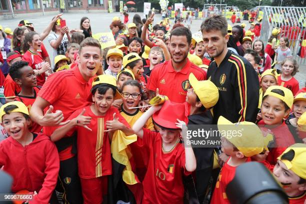 Belgium's midfielder Thorgan Hazard Belgium's forward Eden Hazard and Belgium's Adnan Januzaj meet pupils of the Ecole Fondamentale de Clabecq in...