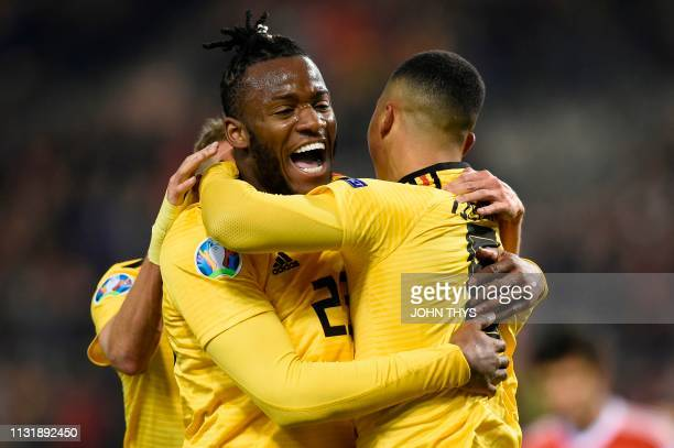 Belgium's midfielder Youri Tielemans celebrates with Belgium's forward Michy Batshuayi after scoring a goal during the Euro 2020 football...