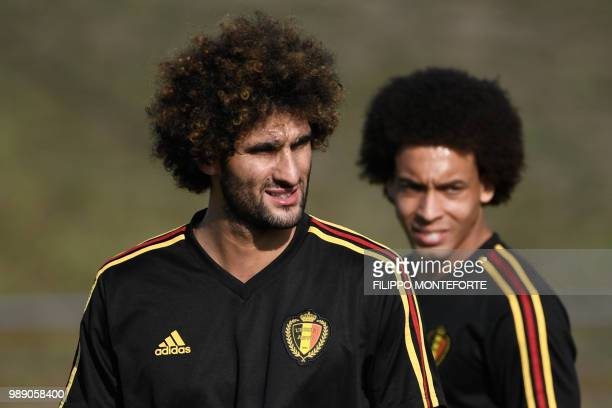 Belgium's midfielders Marouane Fellaini and Axel Witsel take part in a training session in Rostov-on-Don on July 1 on the eve of their Russia 2018...
