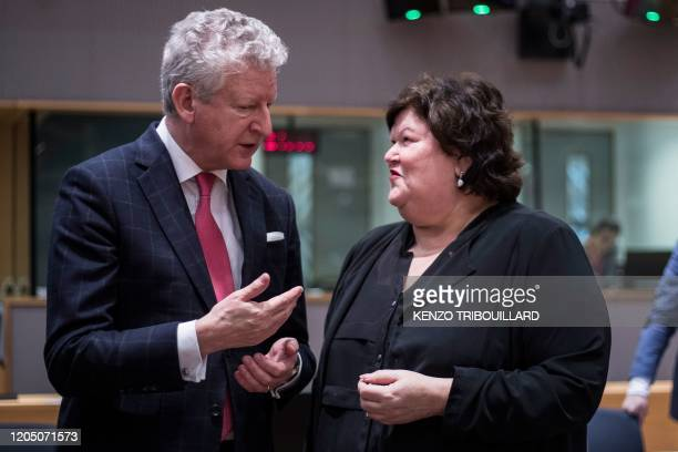 Belgium's Minister of Interior Affairs and Foreign Trade Pieter De Crem speaks with Belgian's Minister of Health Social Affairs Asylum Policy and...