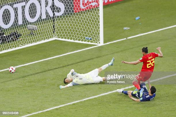 Belgium's Nacer Chadli scores the winner past Japan goalkeeper Eiji Kawashima in stoppage time of a World Cup roundof16 match in RostovOnDon Russia...