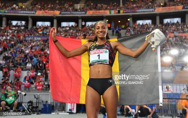 Belgium's Nafissatou Thiam celebrates with her national flag after winning the women's Heptathlon event during the European Athletics Championships...