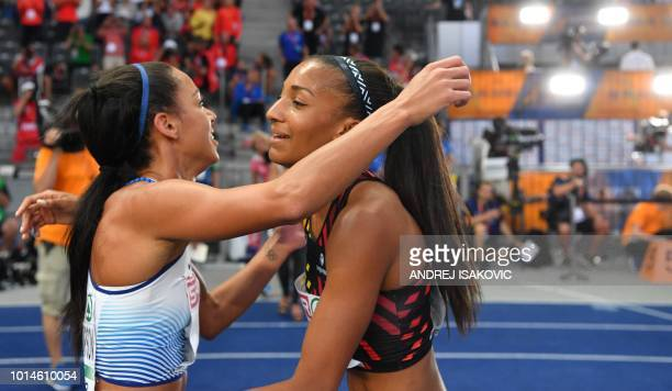 Belgium's Nafissatou Thiam is congratulated by second placed Great Britain's Katarina Johnson-Thompson after winning the women's Heptathlon event...