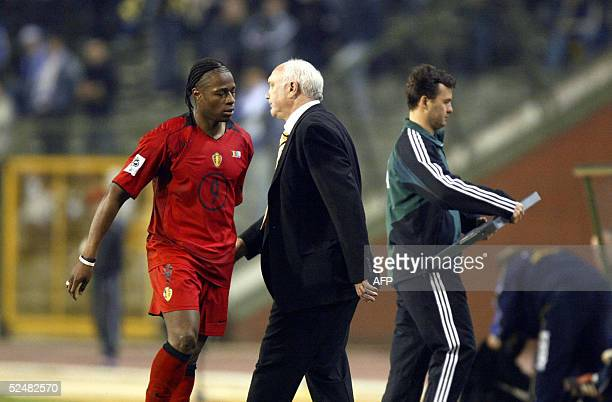 Belgium's national football team coach Aime Anthuenis speaks with Emile Mpenza 26 March 2005 in Brussels during their 2006 World Cup qualifying...