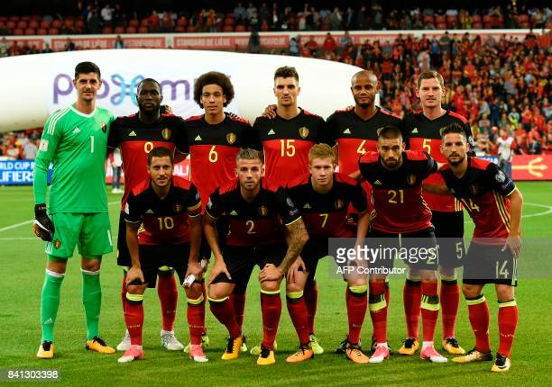 Belgium's national football team players goalkeeper Thibault Courtois forward Romelu Lukaku midfielder Axel Witsel defender Thomas Meunier defender...