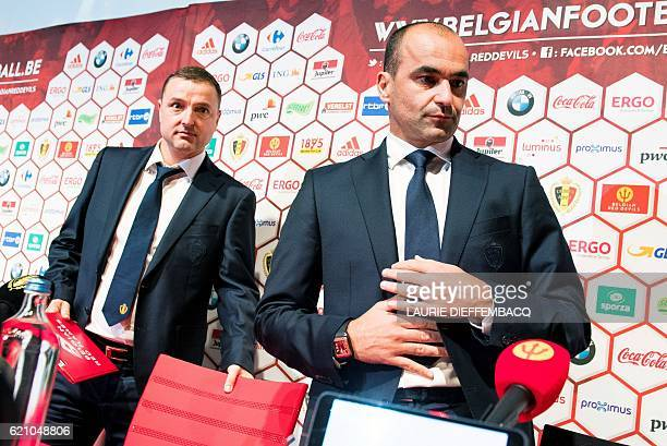 Belgium's national football women team Red Flames head coach Ives Serneels and Belgium's head coach Roberto Martinez take part in a a press...