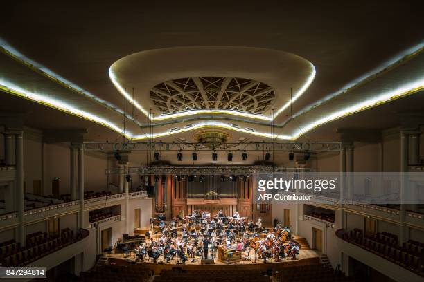 Belgium's National Orchestra and French organist of NotreDame Cathedral in Paris Olivier Latry perform on stage during a rehearsal at the Henry Le...