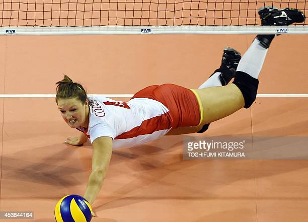 Belgium's Nina Coolman dives to save the ball during their women's volleyball World Grand Prix first day match against China in Tokyo on August 20...
