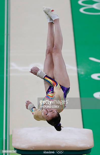 Belgium's Nina Derwael competes in the qualifying for the women's Vault event of the Artistic Gymnastics at the Olympic Arena during the Rio 2016...