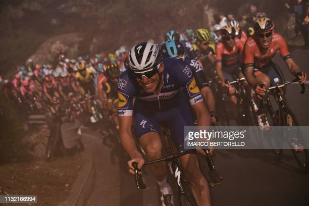 Belgium's Philippe Gilbert and the pack ride in the ascent of Capo Berta during the oneday classic cycling race Milan San Remo on March 23 2019