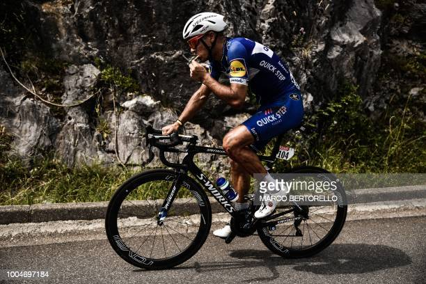 Belgium's Philippe Gilbert eats a snack following his fall during the 16th stage of the 105th edition of the Tour de France cycling race between...