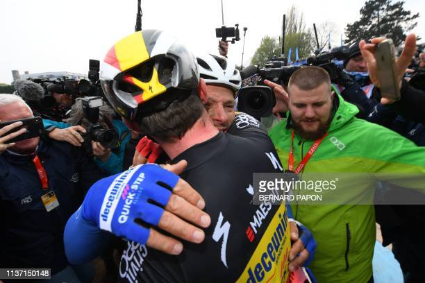 Belgium's Philippe Gilbert is congratulated by teammates after winning the 117th edition of the ParisRoubaix oneday classic cycling race between...