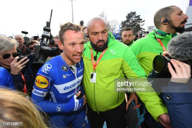Belgium's Philippe Gilbert is escorted through media after winning the 117th edition of the Paris-Roubaix one-day classic cycling race, between...