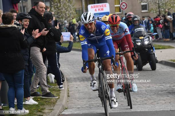 Belgium's Philippe Gilbert leads followed by Germany's Nils Politt during the 117th edition of the Paris-Roubaix one-day classic cycling race,...