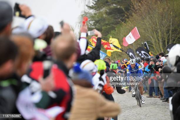 Belgium's Philippe Gilbert rides on the Roubaix cobbled stones sector during the 117th edition of the Paris-Roubaix one-day classic cycling race,...