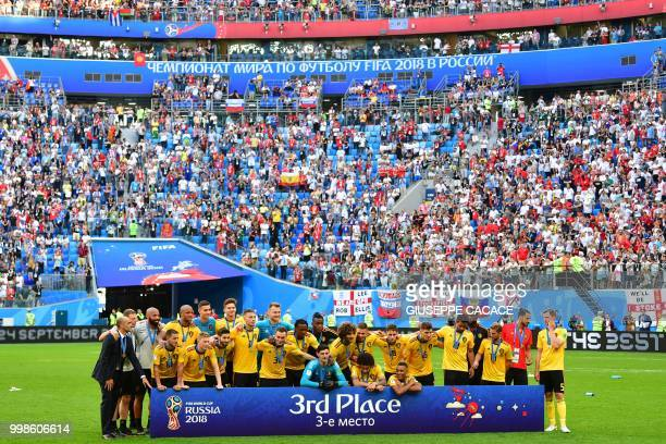 Belgium's players and team members pose with tehir bronze medal after the Russia 2018 World Cup playoff for third place football match between...