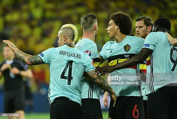 Belgium's players celebrate a goal during the Euro 2016 group E football match between Sweden and Belgium at the Allianz Riviera stadium in Nice on...