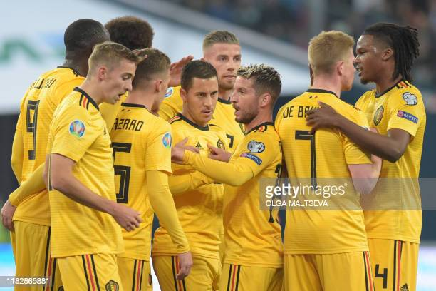 Belgium's players celebrate a goal during the Euro 2020 football qualification match between Russia and Belgium at the Gazprom Arena in Saint...