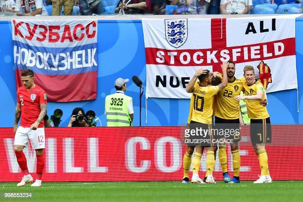 TOPSHOT Belgium's players celebrate after scoring the opener during their Russia 2018 World Cup playoff for third place football match between...