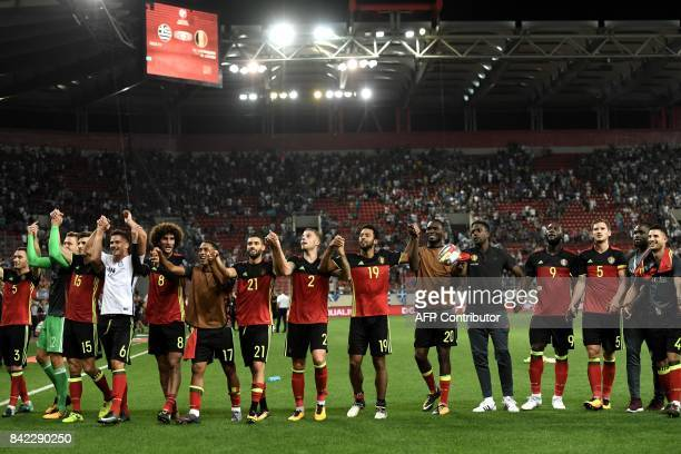 Belgium's players celebrate after their team's victory against Greece in their Group H 2018 FIFA World Cup qualifying football match between Greece...