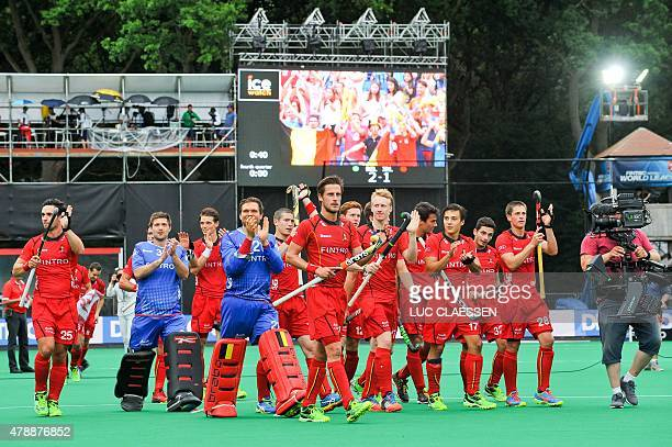 Belgium's players celebrate after winning the Group B field hockey match between Belgium and Ireland of the men's group stage at the World League...